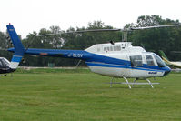 G-BLGV - One of the helicopters at Epsom on 2009 Derby Day