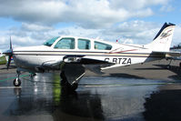 G-BTZA @ EGPT - Beech F33A gets a good clean at Perth Airport in Scotland