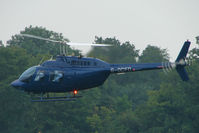 G-OCFD - One of the helicopters at Epsom on 2009 Derby Day