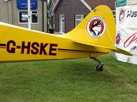 G-HSKE @ EGTB - Tail logo on Husky exhibited at 2009 AeroExpo at Wycombe Air Park