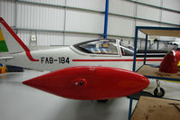 G-SIAI @ EGTB - Hangared  at 2009 AeroExpo at Wycombe Air Park - wears FAB184 markings