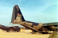70-1266 @ POB - Cropped from a 3 square photo which was centered on the C-123, 54-0700.  Was riding truck to another C-130 to jump. - by Glenn E. Chatfield