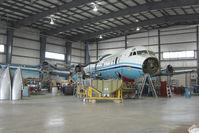 C-FLXT @ CYQF - Air Spray Lockheed Electra