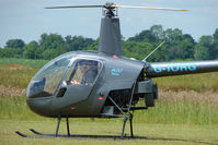 G-IORG @ EGNW - Robinson R22 at Wickenby on 2009 Wings and Wheel Show