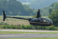G-DMRA @ EGBS - Robinson R44 II at Wolverhampton Business Airport - by Terry Fletcher