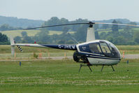 G-JHEW @ EGBS - R22 at Shobdon on the Day of the 2009 LAA Regional Strut Fly-in