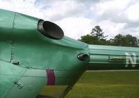 N117CJ - Port engine exhaust - by George A.Arana