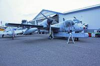N134GA @ ANE - 1960 Grumman OV-1A, c/n: 60-3736 - by Timothy Aanerud