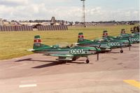 HB-HMC @ EGVA - Pilatus PC-7 of Team Ecco with other team aircraft at the 1991 Intnl Air Tattoo at RAF Fairford. - by Peter Nicholson