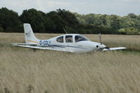 G-CDLY @ EGLG - G-CDLY arriving at Panshanger Airfield. Is the long grass to encourage wildlife ? - by Eric.Fishwick