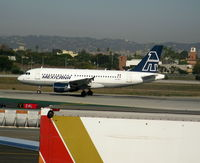 XA-MXJ @ LAX - Mexicana Airbus A-319-112 rolling on RW 24L - by Steve Nation