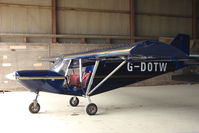 G-DOTW @ EGNY - Hangared aircraft at Beverley