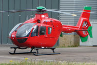 G-WASS @ EGBJ - Eurocopter EC135T2 - Being prepared for Wales Air Ambulance at Gloucestershire (Staverton) Airport