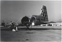 N450T @ HKG - Tail open,ready for cargo.HKG Kai tak 1968 - by metricbolt