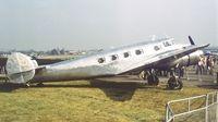 G-LIOA @ EGLF - Lockheed 10 A Electra at Farnborough International 1982