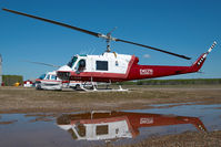 C-GJLV @ CYOJ - Delta Helicopters Bell 204 - reflection - by Dietmar Schreiber - VAP