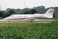 N24SR @ KDPA - Sears Roebuck Learjet 60, taxiing to the Sears hangar KDPA - by Mark Kalfas
