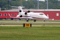 N24SR @ KDPA - Sears Roebuck Learjet 60, deploying reversers, arriving 20R KDPA after a trip from KAVL - by Mark Kalfas