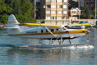 N3125S @ CYWH - Kenmore Air Dash 3