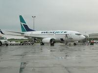 C-FWAD @ CYYG - Aircraft in Charlottetown, PE on a rainy day - by ralph spielman