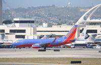 N233LV @ KLAX - Southwest Boeing 737-7H4, N233LV KLAX. - by Mark Kalfas