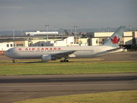 C-GDUZ @ EGLL - Air Canada taxiing to r/w - by Robert Kearney