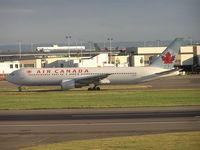 C-GDUZ @ EGLL - Air Canada taxiing to r/w - by Robert Kearney