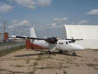 C-FCPV @ YXE - white twin motor plane - by larry hicks