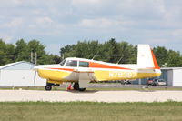 N79397 @ KOSH - Mooney M20E - by Mark Pasqualino