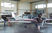 D-EFJG @ EDKB - Bölkow Bo 209 Monsun in a maintenance hangar during the Bonn-Hangelar centennial jubilee airshow - by Ingo Warnecke