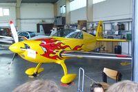 D-EXFT @ EDKB - Extra EA 200 in a maintenance hangar during the Bonn-Hangelar centennial jubilee airshow - by Ingo Warnecke