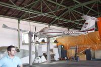 D-EBEC @ EDKB - Diamond DA-20-A1 Katana in hangar during the Bonn-Hangelar centennial jubilee airshow