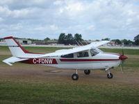 C-FDNW @ KOSH - Cessna T210L - by Mark Pasqualino