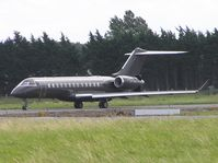 N711MC @ EINN - Global Express waiting to line up - by Robert Kearney