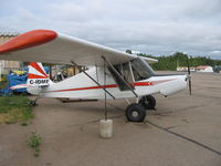 C-IDME @ CYYE - Modified with Rotax 912,storage behind seat,big rubber - by owner