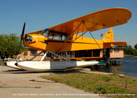 N10510 @ F57 - Beached at Brown's Seaplane Base - by J.G. Handelman