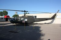 69-15012 @ OSH - uh-1 - by Timothy Aanerud