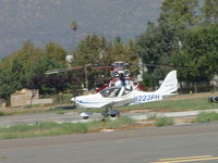 N223PH @ POC - Landing on 26R, just south of north helitanker pad - by Helicopterfriend