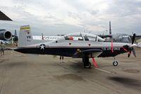 07-3901 @ OSH - Raytheon/Beech T-6A II, c/n: PT-460 - by Timothy Aanerud
