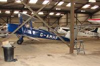 G-AMHF @ EGBK - Tiger Moth hangered at Sywell
