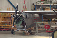 G-AEXD @ EGBK - Aeronca 100 hangared at Sywell
