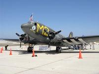 N45366 @ CMA - 1943 Douglas C-53D SKYTROOPER 'D-DAY DOLL', two Curtiss-Wright R-1820-56 1,200 Hp each, nose art - by Doug Robertson