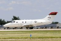 91-0102 @ KOSH - Landing 27 at OSH - by Todd Royer