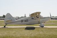 CF-AZZ @ KOSH - Taxi to parking - by Todd Royer
