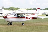 C-FDNW @ KOSH - Taxi to parking - by Todd Royer