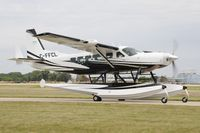 C-FFCL @ KOSH - Taxi for departure - by Todd Royer