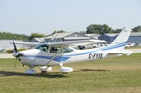 C-FYIS @ KOSH - Taxi to parking - by Todd Royer