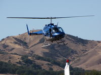 N10KX @ 1O2 - 1975 Bell 206B on approach to Lampson Field (no longer dusting) - by Steve Nation