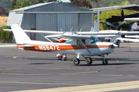 N68472 @ 1O2 - Christiansen Aviation 1978 Cessna 152 taxiing by flyable Grumman TF-1 @ Lampson Field - by Steve Nation