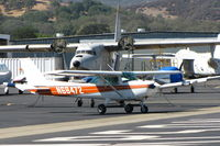 N68472 @ 1O2 - Christiansen Aviation 1978 Cessna 152 taxiing by derelict Grumman HU-16E and TF-1 @ Lampson Field - by Steve Nation